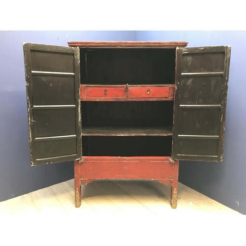 27 - A Red  lacquered Chinese cabinet with fitted shelves & drawers 176cm...
