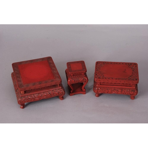 31 - Three C19th Chinese carved cinnabar lacquer stands, 15cm wide max (3)...