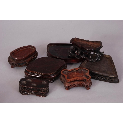 33 - Group of seven Chinese wood stands (7)...
