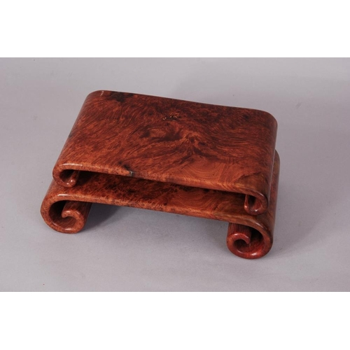 37 - Two Chinese scroll-shaped burlwood stands, 26.6cm wide max (2)...