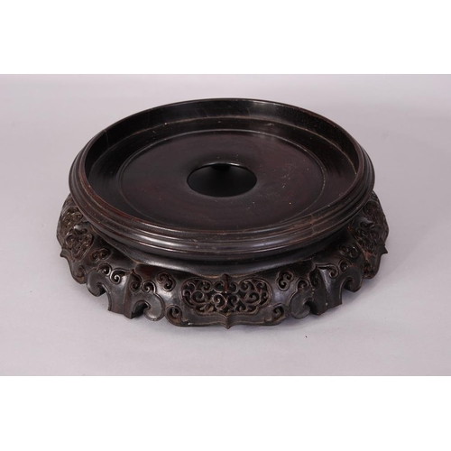 39 - Large Chinese carved circular wood stand, 33.5cm diam....