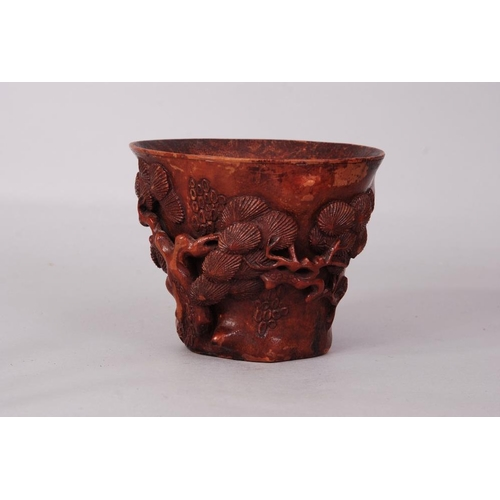 50 - Chinese bamboo libation cup carved and pierced as a gnarled pine trunk with foliate branches, 11.2cm...