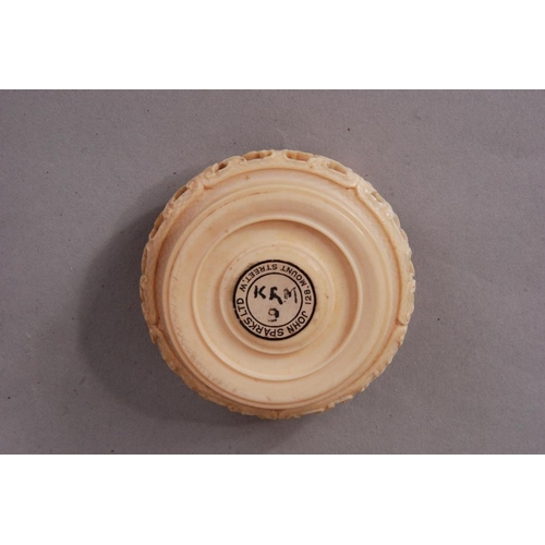 57 - C18th Chinese carved ivory circular stand, bearing 'John Sparks Ltd' label; together with a further ...