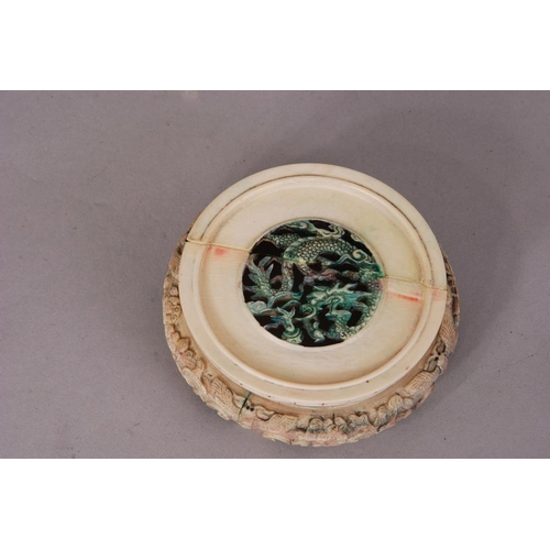 59 - C18th/19th Chinese ivory circular stand carved and pierced with dragon, fruiting and flowering branc...