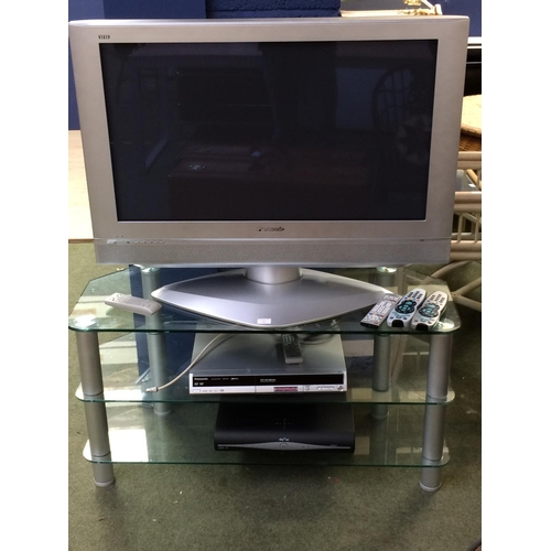 11 - Panansonic tv, dvd & sky box on glass 2 tier table (cannot guarantee working)...