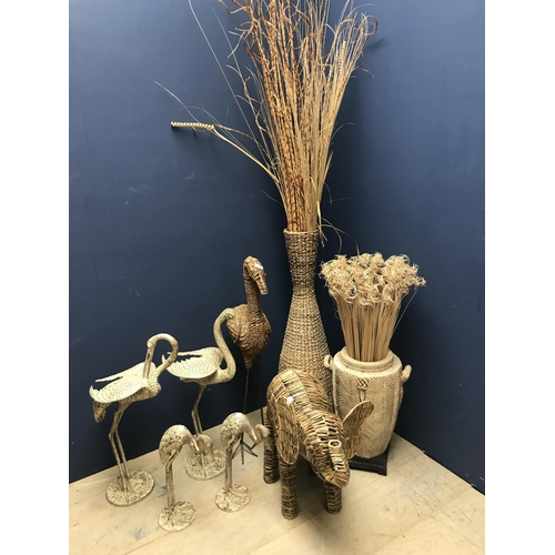 25 - Qty of decorative wicker ornaments including storks, elephant etc...