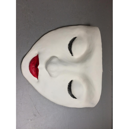 29 - Novelty hanging mask of a ladies face...