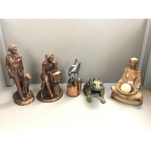 51 - 2 Bronze style figures, bronze avocet on a log & 2 candle holders (a seated lady and a frog)...