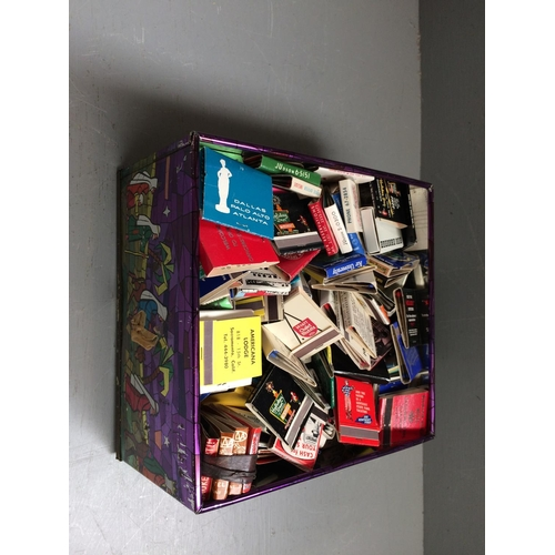 57 - Biscuit tin filled with book matches from around the world...