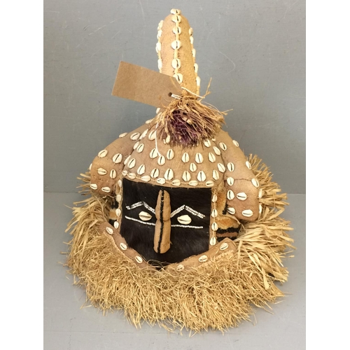 9 - African hessian tourist mask decorated with animal fur, shells & grasses (selling for Prospect Hospi...