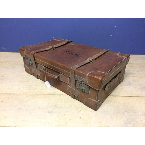 21 - Large leather suitcase with straps F.S.M to the top...