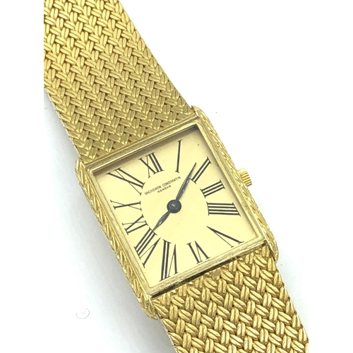 42 - A Vacheron Constantin gold wrist watch, Geneve, stamped 750, 129 to clasp inscribed verso with origi...