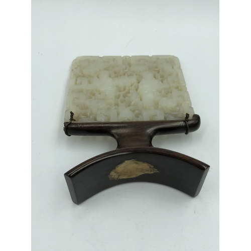 456 - Chinese C18th/19th pierced and carved jade plaque, wood stand, 11x7 cm...