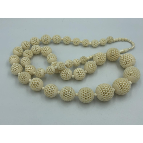 459 - Chinese C19th jade necklace, and  ivory necklace...