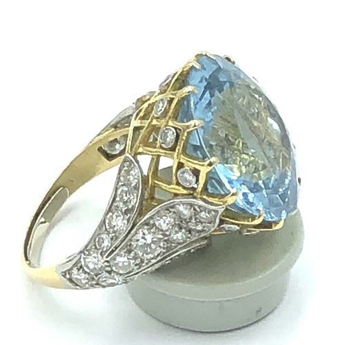 83 - Unmarked yellow metal  aquamarine diamond dress ring, central round free cut aquamarine 19mm in pier...