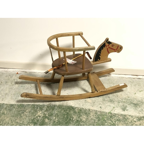 22 - Hobby style rocking seat with painted horses head & a whip...