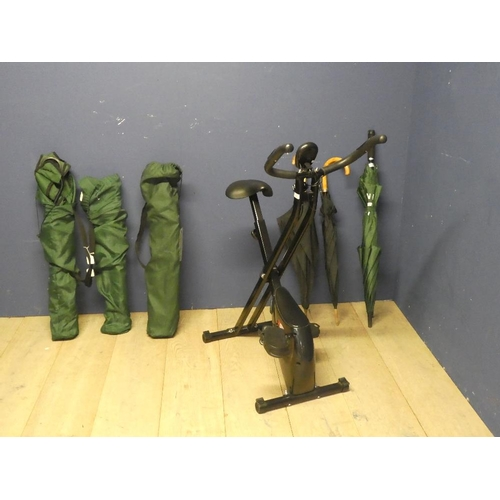 14 - Folding exercise bike, 3 folding camping chairs in bags, 3 umbrellas...