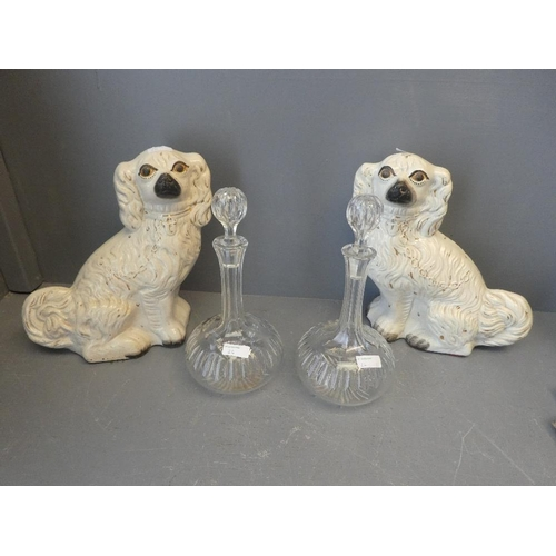 26 - Two ornamental dogs and two decanters...