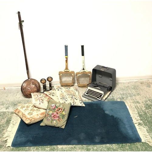 63 - General items inc typewriter, tennis rackets, bed warmer, fire dogs, rug and cushions...