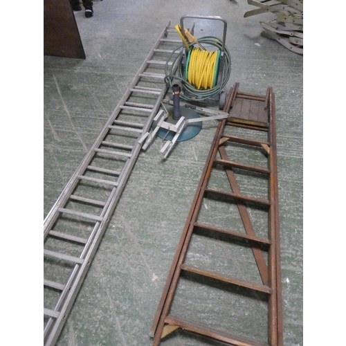 71 - A quantity of outdoor items to include two ladders, a hose on reel umbrella stand etc....