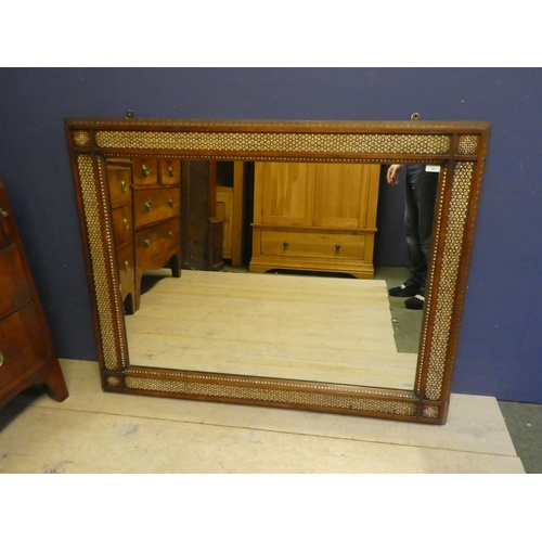 60 - Rectangular wall mirror in the Moorish taste, the wooden frame pierced & decorated with mother of pe...