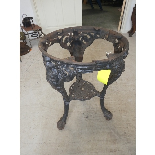 73 - Cast iron decorated table base on tripod stand, 68cmH x 48cm diameter....