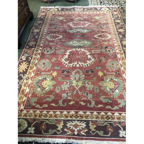 53 - Contemporary pink ground rug with green medalions, 280 x 188cm...
