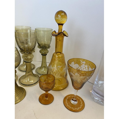 36 - Qty of glass wear to include decanters, cut glass drinking stemmed glasses, tumblers, coloured glass...