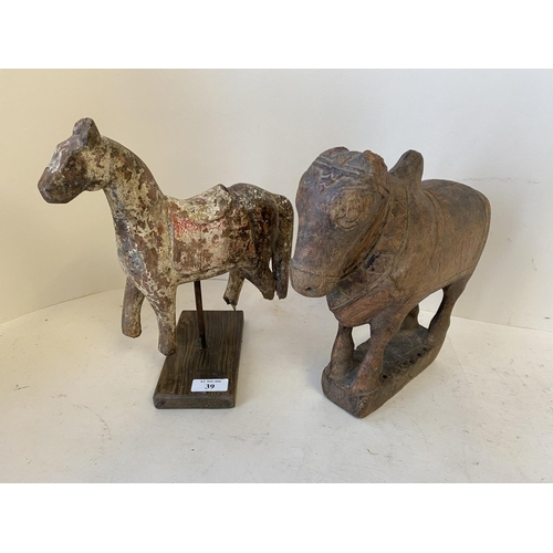 39 - Decorative model of a horse on a wooden plinth and a cow...