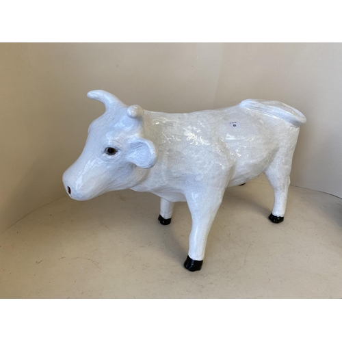 40 - Crackle glazed China model of a standing white cow.  41H x 66L   CONDITION: some general all over we...
