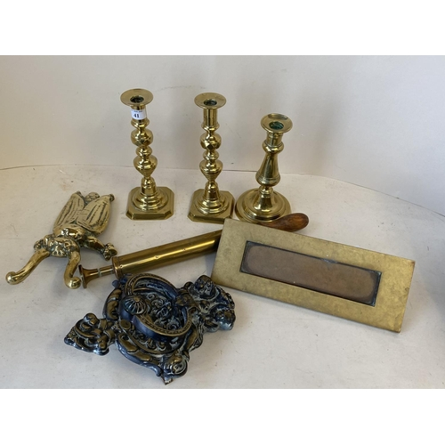 41 - Qty of brass candle sticks and boot jack in the form of  beetle, brass letter box & door knocker.  C...