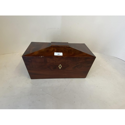 44 - Figured mahogany tea caddy with lion mask ring handles and fitted interior with glass mixing bowl.  ...