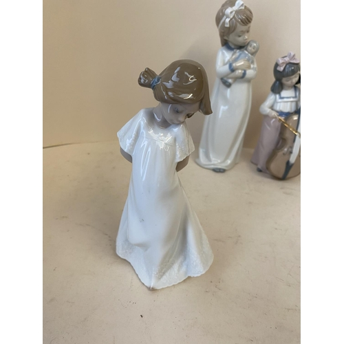 56 - Qty of Nao & Lladro figurines see images for details CONDITION: no obvious signs of restoration or d...