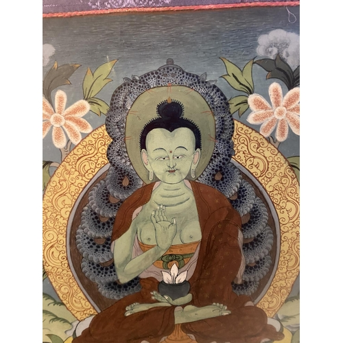 37 - Framed and glazed Tibetan Thangka, mounted within a green and purple fabric mount, size including fa...