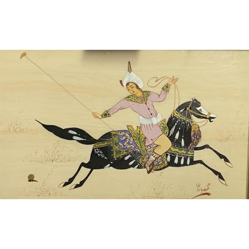 57 - Pair of Iranian figures on horses in decorative clothing, playing a form of polo, in deep fabric gil...
