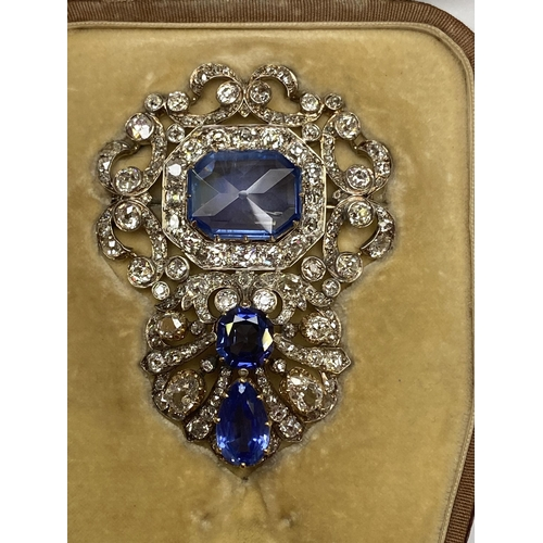 14 - Late C19th/early C20th Sapphire and diamond brooch, set with 3 free cut sapphires, central untreated...