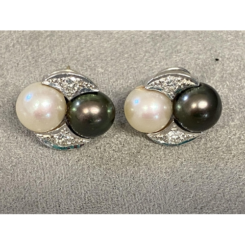 2 - Pair of 18ct white gold and platinum Tahitian white and black pearl ear studs, with diamond accents,...