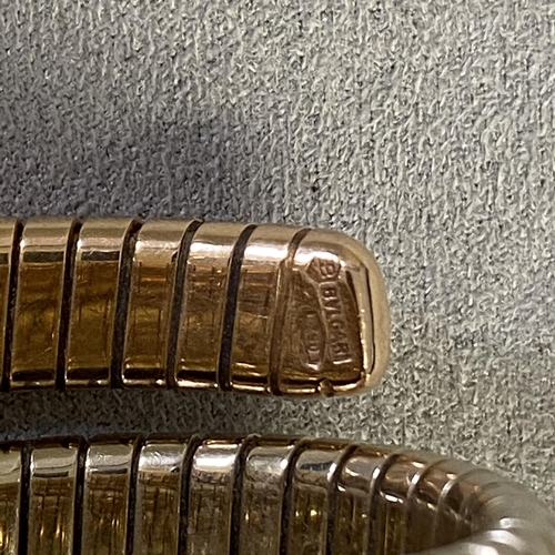 26 - 18ct gold Bulgari cocktail watch on sprung 18ct gold Bulgari strap, black face (Provenance lots 12 t...