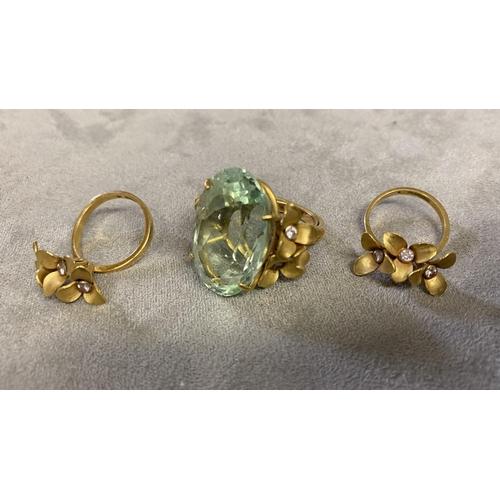 29 - Unmarked yellow metal aqua/tourmaline marine and diamond dress ring, central oval free cut sapphire,...