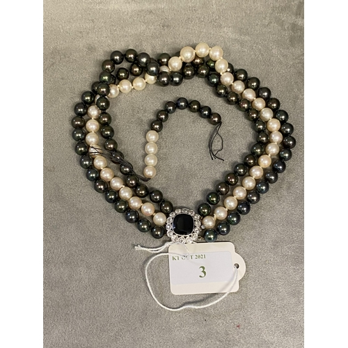 3 - Triple strand of graduated Tahitian pearls of purple, green and white hues, largest pearl is 10mm wi...