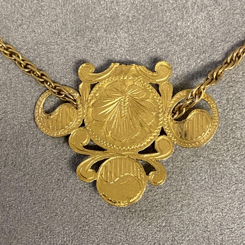 31 - Unmarked yellow metal Chinese pendent on a 14ct gold ripe twist necklace, 22.5g