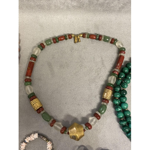 39 - Collection of beaded jewellery, graduated cherry amber strand, uniform double strand of malachite be...