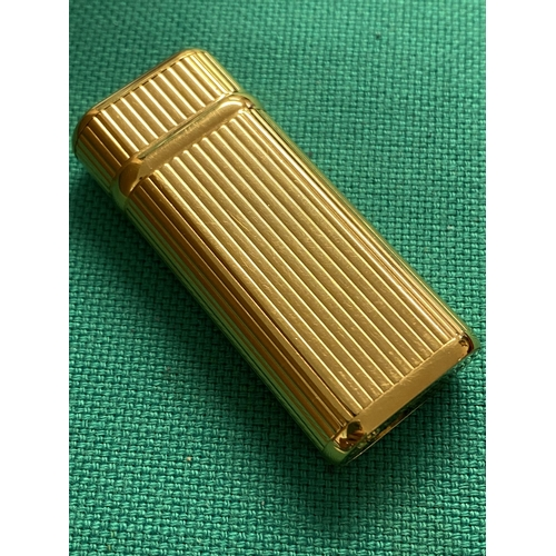 44 - A Cartier gold plated lighter, Swiss made, good condition