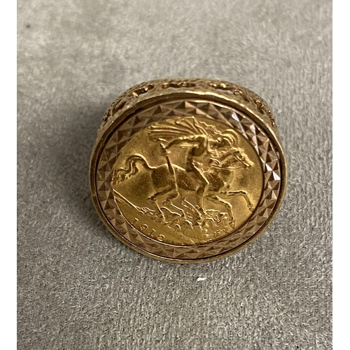 46 - Half sovereign signet ring, in a 9ct gold open work mount, 7.8g, size R