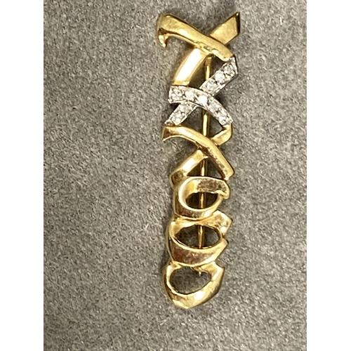 28 - Tiffany & Co 18 ct gold and platinum diamond set bar brooch, 4g