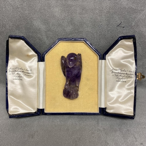 35 - Carved amethyst model of a parrot with intagio stamp to base, in a James Ogdon and Sons fitted box,
