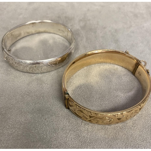 64 - Sterling silver bangle together with a 9 ct gold  plated example