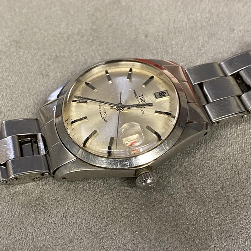 55 - Gents stainless steel Tudor Rolex wrist watch, a 38mm silvered face, with red date aperture at 3 and...