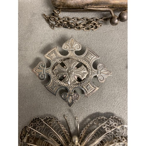 52 - Sterling silver Scottish hardstone brooch in the form of an axe, and 2 white metal filigree brooches...