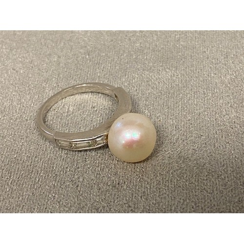13 - CARTIER, LONDON, Natural salt water pearl and diamond  and platinum ladies ring, central natural pea...